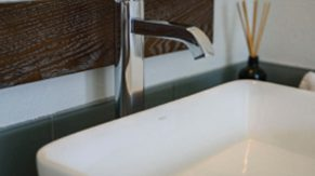Shiny sink details done by Complete Home Care, a bathroom remodeling company in Boca Raton, FL.
