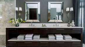 Under the sink shelving done by Complete Home Care, a bathroom remodeling company in Boca Raton, FL.