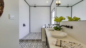 Intricate bathroom flooring design by Complete Home Care, in Boca Raton, FL.