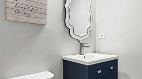 A new vanity with three overhead lights, done by Complete Home Care, a bathroom remodeling company in Boca Raton, FL.