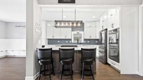 Saddle up to this breakfast bar kitchen remodeling project by Complete Home Care.