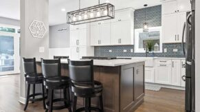 A breakfast bar and kitchen island example by kitchen remodeling contractors, Complete Home Care.